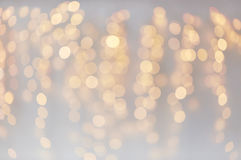 Christmas decoration or garland lights bokeh. Holidays, background and illumination concept - blurred golden christmas decoration or garland lights bokeh Stock Image