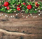 Christmas decoration garland with red apple and golden lights Stock Image