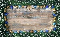 Christmas decoration and garland on a wooden board, copy space. Christmas ornaments and green garland on a wooden board, copy space Stock Photo