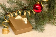 Christmas decoration and gift box. Hanging ball, gift box, streamer and spruce branch, Christmas concept Stock Images