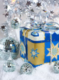 Christmas decoration with gift box. In silver color and mirror balls royalty free stock photo
