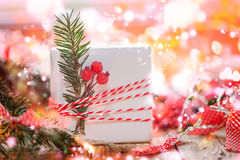 Christmas Decoration gift box and gold jingle bells with branch fir and boke. Holiday greeting card. Royalty Free Stock Images