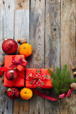 Christmas decoration with gift box over old wooden background. Royalty Free Stock Photography