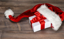 Christmas decoration. Gift box with red ribbon bow Royalty Free Stock Photography