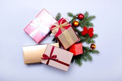 Christmas decoration with gift box, tree and color balls. Royalty Free Stock Images