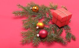 Christmas decoration with gift box, tree and color balls. Stock Image