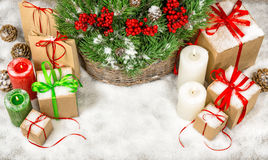Christmas decoration with gift boxes and burning candles Stock Photography