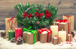 Christmas decoration with gift boxes and burning candles Stock Images
