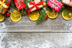 Christmas decoration with gift boxes, fir tree and oranges Stock Photos