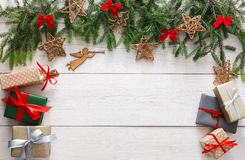 Christmas decoration, gift boxes and garland frame background Stock Photos