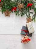 Christmas decoration, gift boxes and garland frame background Royalty Free Stock Photo