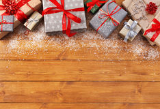 Christmas decoration, gift boxes and garland frame background. Christmas decoration, gift boxes and garland frame concept background, top view with copy space on Royalty Free Stock Images