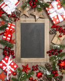 Christmas decoration gift boxes red stars ornaments chalkboard. Christmas decoration gift boxes, red stars, ornaments and chalkboard for your text stock image
