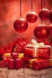 Christmas decoration - gifts, balls and candles Stock Photos