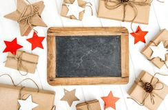 Christmas decoration gifts and chalkboard Royalty Free Stock Photos