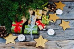 Christmas decoration with gifts and present boxes under a pine tree.Golden harmony. royalty free stock photos
