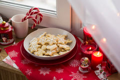 Christmas decoration: gingerbread cookies, candies, toys and burning red candles Royalty Free Stock Photography