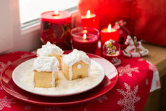 Christmas decoration: gingerbread houses, candies, toys and burning red candles Royalty Free Stock Image