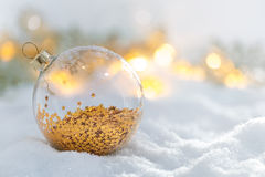 Christmas decoration glass ball at snowy sunrise Royalty Free Stock Image