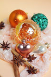 Christmas decoration with glossy baubles, star anise and cinnamo Stock Photography