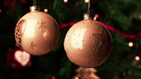Christmas decoration gold balls movement. christmas tree lights bokeh stock footage