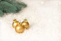 Christmas decoration with gold balls snow and christmas tree branches. Christmas decoration with gold balls snow and christmas tree branches Royalty Free Stock Photos