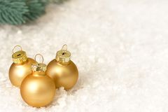 Christmas decoration with gold balls snow and christmas tree branches. Christmas decoration with gold balls snow and christmas tree branches Royalty Free Stock Image