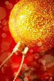 Christmas decoration with gold baubles. Blurred image of Christmas decoration with gold baubles and glitter on red background. Xmas and new year greeting. Close Stock Image