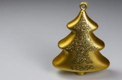 Christmas decoration - gold glass tree. Christmas decoration of gold glass tree on light background Stock Photography