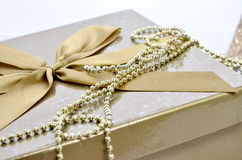 Christmas decoration. Christmas gold present with bow Stock Image