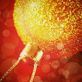 Christmas decoration with gold shiny bauble Royalty Free Stock Image