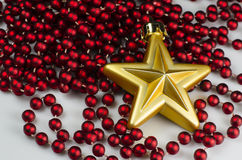 Christmas decoration - gold star with chain Royalty Free Stock Photo