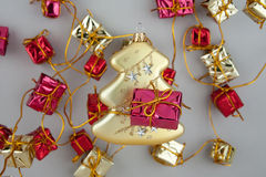 Christmas decoration gold tree with garland Stock Photo