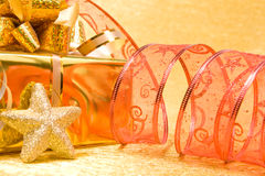 Christmas Decoration on a golden background with copyspace for t Royalty Free Stock Photography