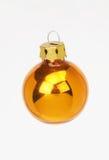 Christmas decoration golden ball - goldene weihnachstkugel. Christmas decoration golden ball on white background - goldene weihnachstkugel vor weissem royalty free stock image