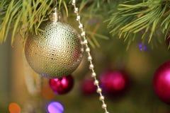 Christmas decoration golden ball. On christmas tree Stock Photography