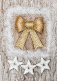 Christmas decoration with golden bow and silver stars Stock Image