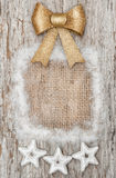Christmas decoration with golden bow and silver stars Stock Photos
