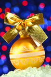 Christmas decoration, golden Christmas ball with golden bow Royalty Free Stock Image