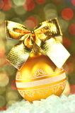 Christmas decoration, golden Christmas ball with golden bow Royalty Free Stock Images