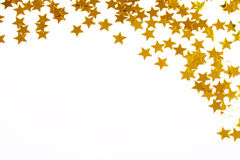 Christmas decoration of golden confetti stars Royalty Free Stock Photos