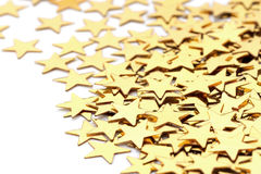 Christmas decoration of golden confetti stars against Royalty Free Stock Image