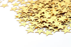 Christmas decoration of golden confetti stars against Royalty Free Stock Images