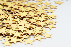 Christmas decoration of golden confetti stars against Royalty Free Stock Photography