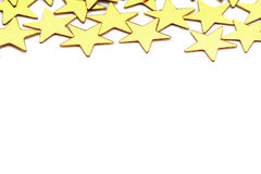 Christmas decoration of golden confetti stars against Stock Image