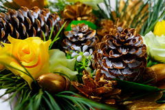 Christmas decoration with golden fir cones and silk roses Royalty Free Stock Images