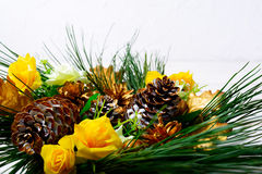 Christmas decoration with golden fir cones on white background Stock Images