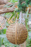 Christmas decoration. Golden christmas decoration hanging between other decorations royalty free stock photo