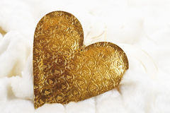 Christmas decoration, golden heart on fur blanket Stock Images