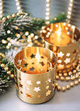 Christmas decoration with golden lanterns and lights Stock Photos